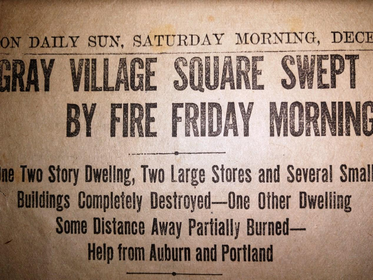 Gray Village Square Swept by Fire newspaper heading