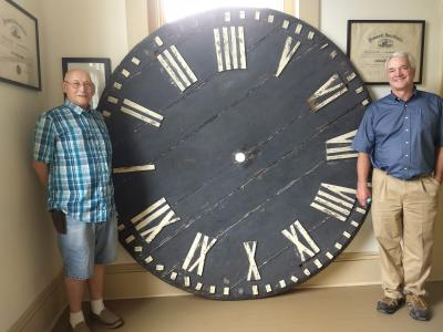 photo of Pennell clock face with Don Whitney & Doug Webster
